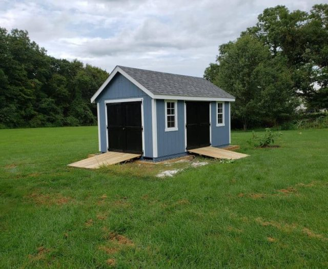 A-Frame Shed with Black Doors, White Trim, Blue T-111 Siding and Wooden Ramps