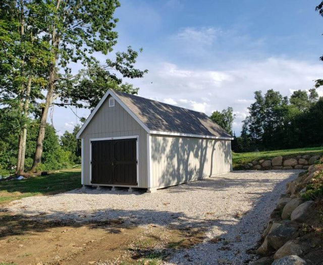 A-Frame Shed with Gray T-11 Siging, White Trim and Black Double Door