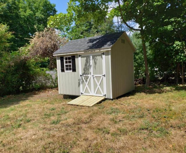 A-Frame Shed with Lt Green T-111 Siding, White Trim, Wooden Ramp and Black Shutters