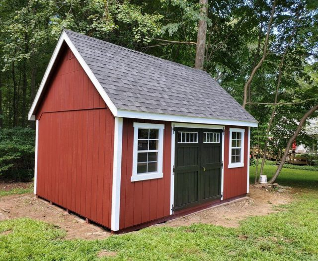 A- Frame Shed with Red T-111 Siding, White Trim and Black Double Doors
