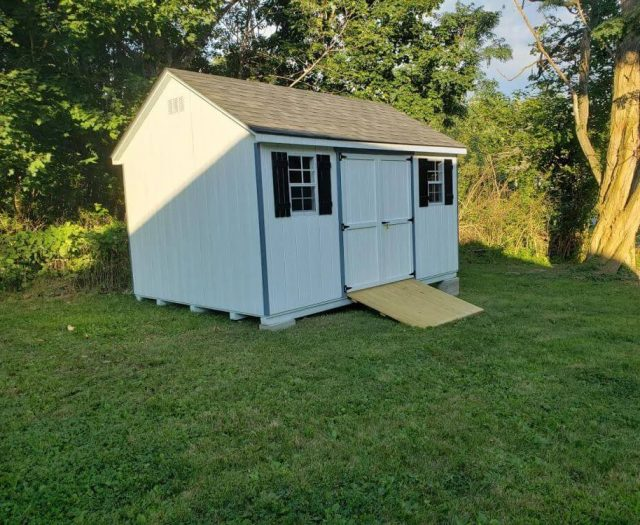 A-Frame Shed with White T-111 Siding and Door, Black Shutters, Blue Trim, and Wooden Ramp