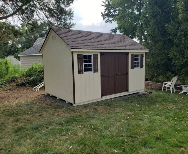 A- Frame Shed with Yellow T-111 Siding, Brown Double Door, Shutters and Trim
