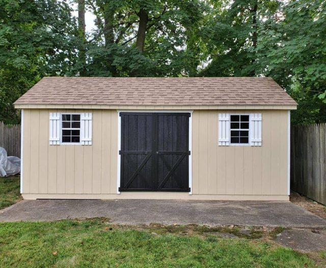 A-Frame Storage Shed with Yellow T-111 Siding, White Trim and Shutters, and Black Double Door