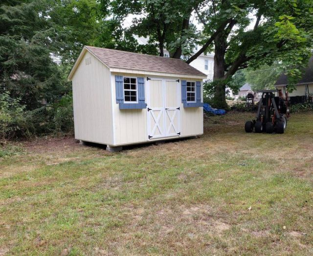 A-Frame Storage Shed with Yellow T-111 Siding, White Trim and Blue Flower Boxes and Shutters