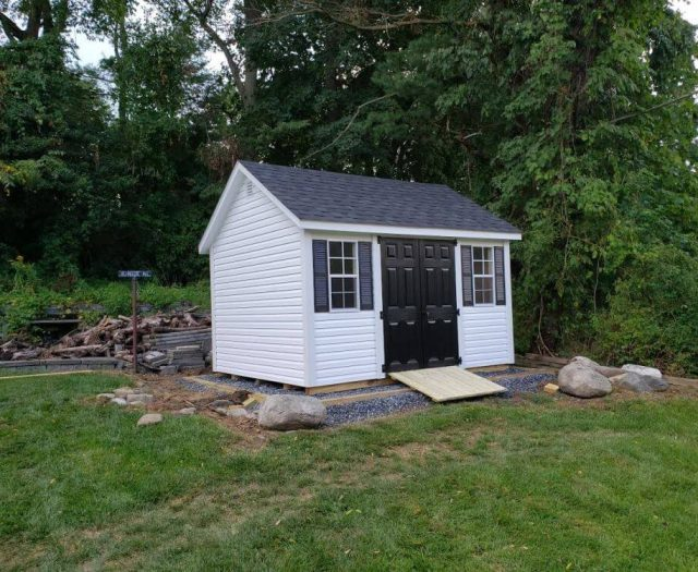 A-Frame White Vinyl Siding, Black Door and Shutter with Wood Ramp