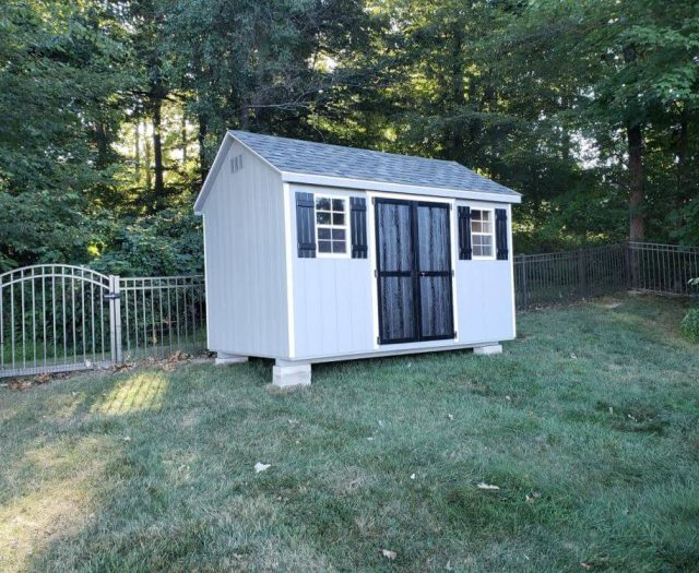 A-Frame with Blueish T-111 Siding, White Trim, Black Door and Shutters