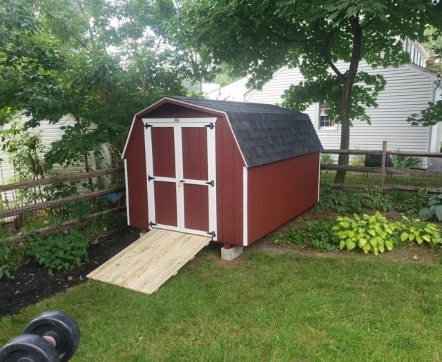 Barn Shed with Red T-111 Siding and White Trim