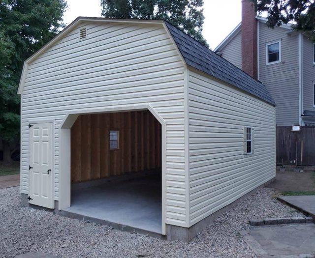 Dutch Barn Single Car Garage with Yellow Vinyl Siding, Trim and Door
