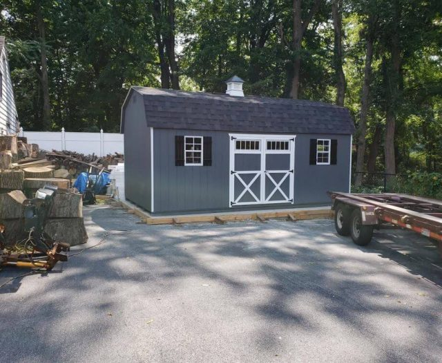 Dutch Barn with D. Blue T-111 Siding, White Door Trim, Black SHutters, Coupla)