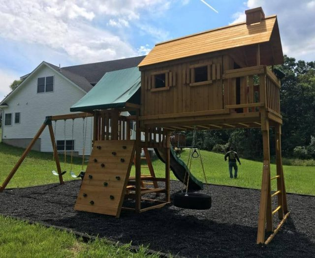 Fantasy Tree House Swing Set with Black MulchFantasy Tree House Swing Set with Black Mulch