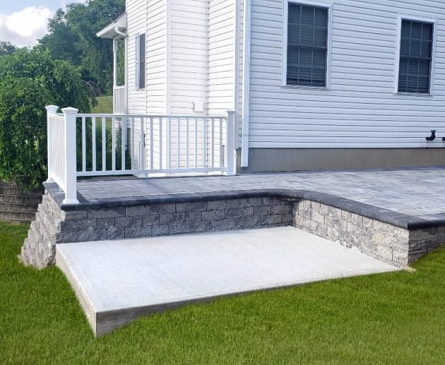 On Site- White Vinyl Railing Stone Patio with Hot Tub Pad