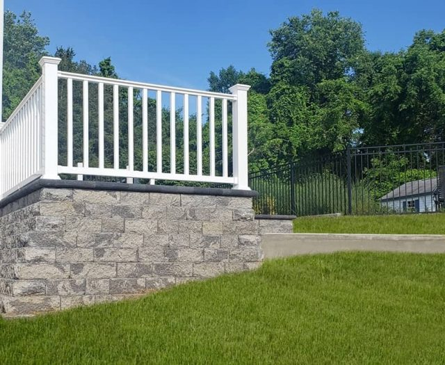 On Site- White Vinyl Railing with Stone Retaining Wall