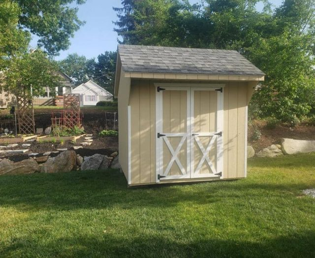 Quaker Storage Shed with T-111 Yellow Siding and White Trim