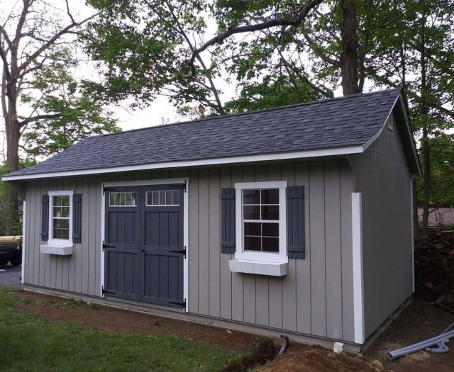 Quaker Storage Shed with White Trim and Dk. Blue Double Doors and Shutters