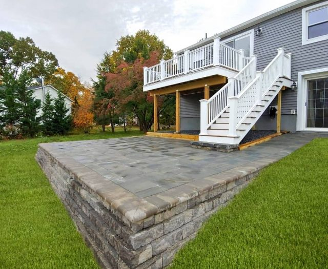 Stone Patio with White Vinyl Composite Deck