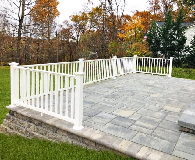 White Vinyl Railings on Stone Patio