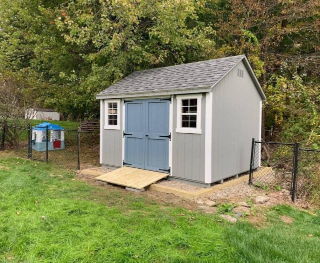 A-Frame Backyard Shed with Gray T-111 Siding, Blue Door, White Trim, and PT Ramp