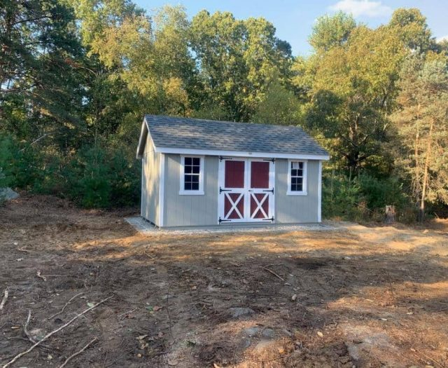 A- Frame Backyard Shed with Gray T-111 Siding, Red Door and White Trim and Shutters