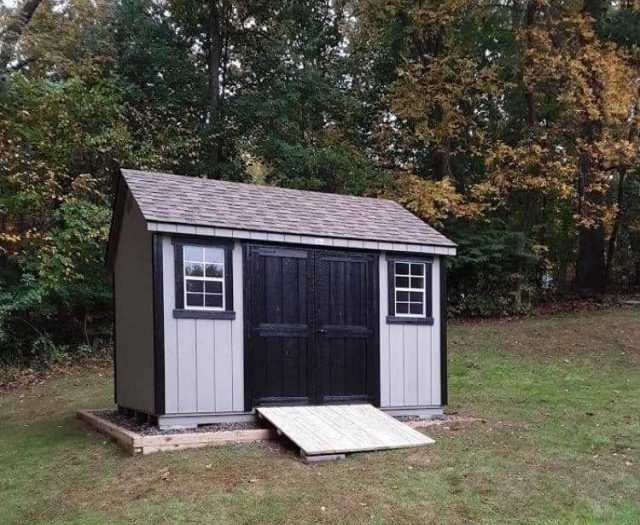 A- Frame Outside Shed with Gray T-111 Siding, Back Doors and Trim, and Pressure Treated Wooden Ramp