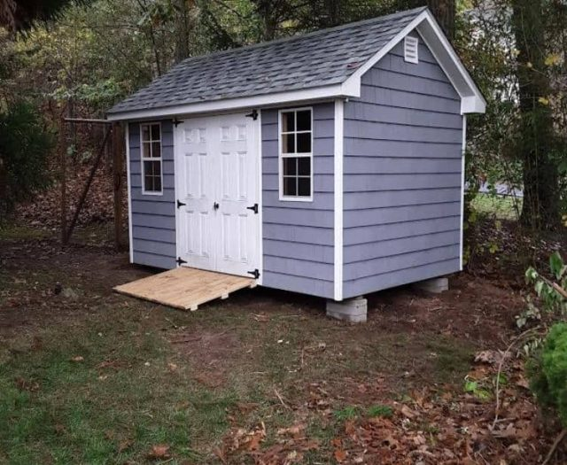 A- Frame Shed with Blue Vinyl Cedar Shake Siding, White Doors and White Trim