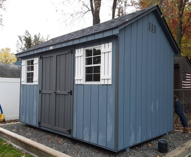 A- Frame Storage Shed with Blue T-111 Siding, Gray Door and White Shutters