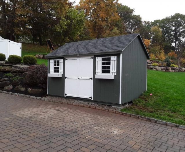 A- Frame Storage Shed with Dark Gray T-111 Siding, White Flower Boxes and White Shutters