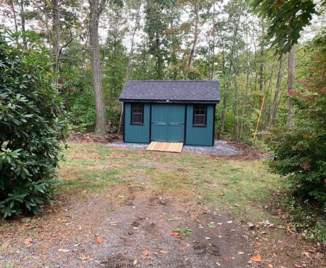 A- Frame Storage Shed with Dk Blue T-111 Siding, Black Trim and Shutters, and PT Ramp
