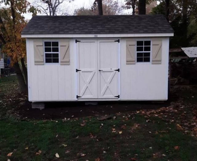 A- Frame Storage Shed with White T-111 Siding, White Doors, and Tan Shutters
