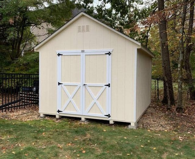 A- Frame Storage Shed with Yellow T-111 Siding and White Trim Side Door