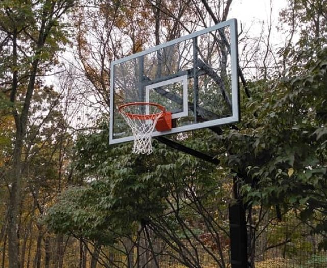 All American Inground Basketball Hoop in Dirt with Flexr Net