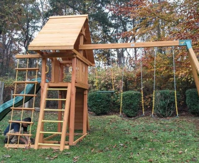 Dreamscape Playground with Swings, Wood Roof, and Ladder
