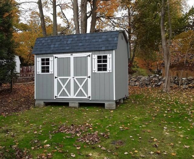 Dutch Barn Shed with Blue Gray T-111 Siding, White Trim, and White Shutters