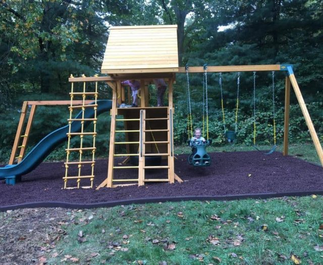 Extreme Swing Set with Horse Glider, Monkey Bars, Wood Roof, and Brown Rubber Mulch