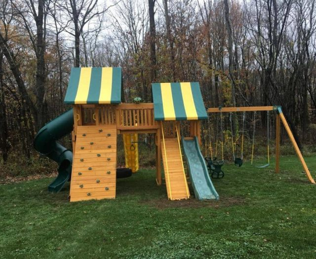 Fantasy Jungle Gym with Slides, Horse Glider, and Rock Wall