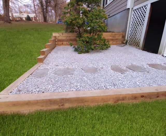 PT Wooden Retaining Wall and Gravel Pad