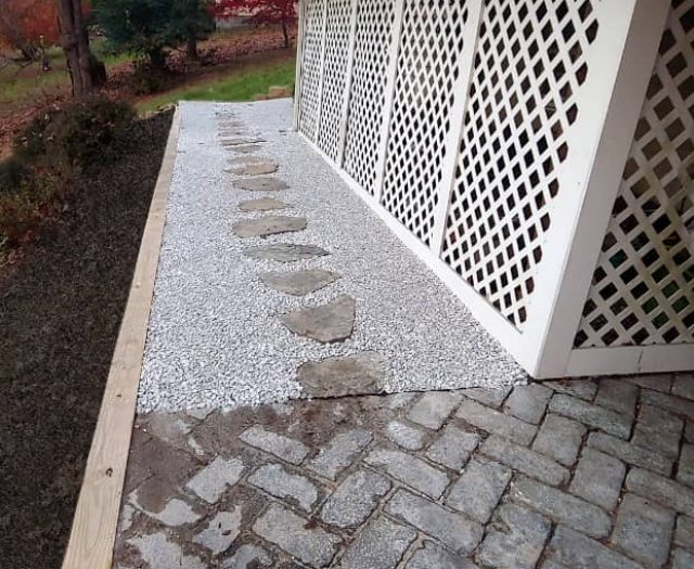 Wooden Retaining Wall and Gravel Walkway