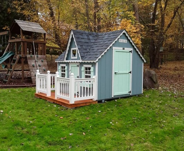 Victorian Kids Playhouse with Blue T-111 Siding, Deck, and White Trim