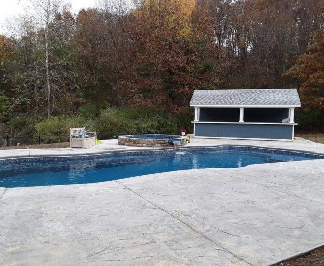 white columns outside luxury pool cabana