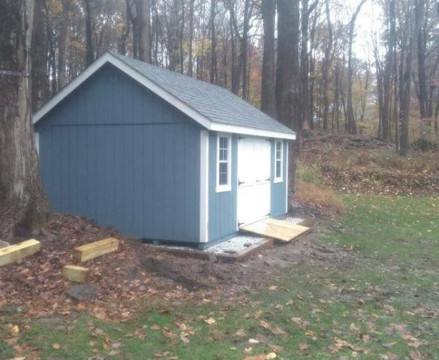 A- Frame Backyard Shed with Blue Wooden Siding, White Trim, and PT Ramp