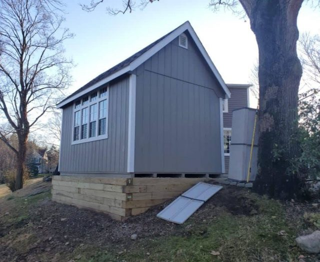 A- Frame Backyard Shed with Gray T-111 Siding, White Trim, and Giant Windows