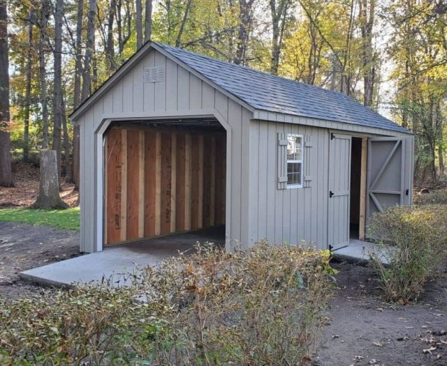 A- Frame Backyard Shed with Gray T-111 Siding, Windows, Garage Door, and Side Double Door