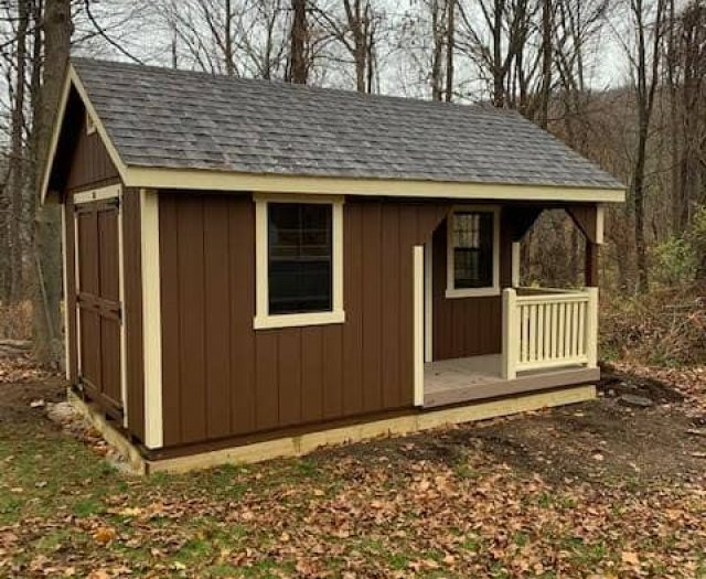 A-Frame Shed with Brown T-111 Siding, Deck, and Tan Trim