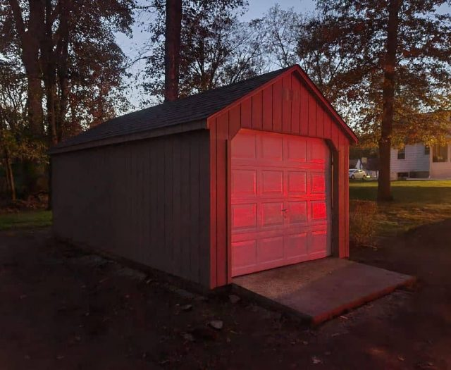 A- Frame Shed with Garage Door, Concrete Pad, and Roof