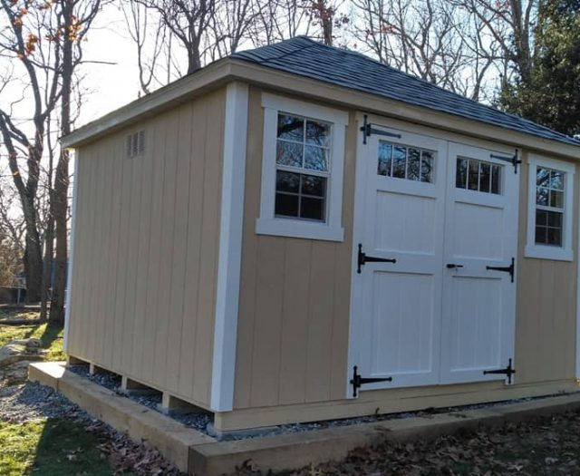 A- Frame Shed with Yellow T-111 Siding, White Trim, and Double Doors