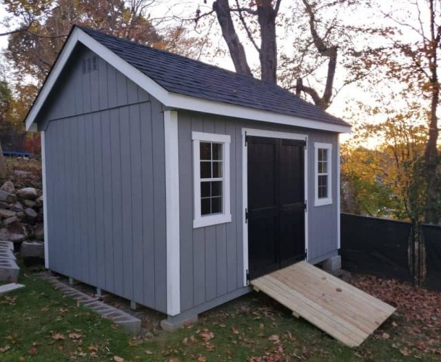 A- Frame Storage Shed with Blue T-111 Siding, Wooden Ramp, and White Trim