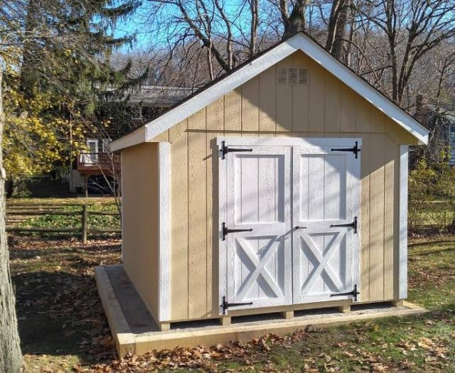 A- Frame Storage Shed with Yellow T-111 Siding, White Double Door, and White Trim