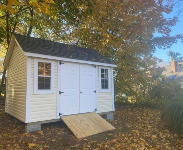 A- Frame Storage Shed with Yellow Vinyl Siding, White Double Doors, and Windows