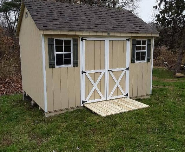 A-Frame Yellow T-111 Siding, White Trim, and Olive Shutters