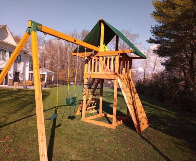 Dream Swing Set with Bucket Swing, Rock Wall, and Ships Wheel