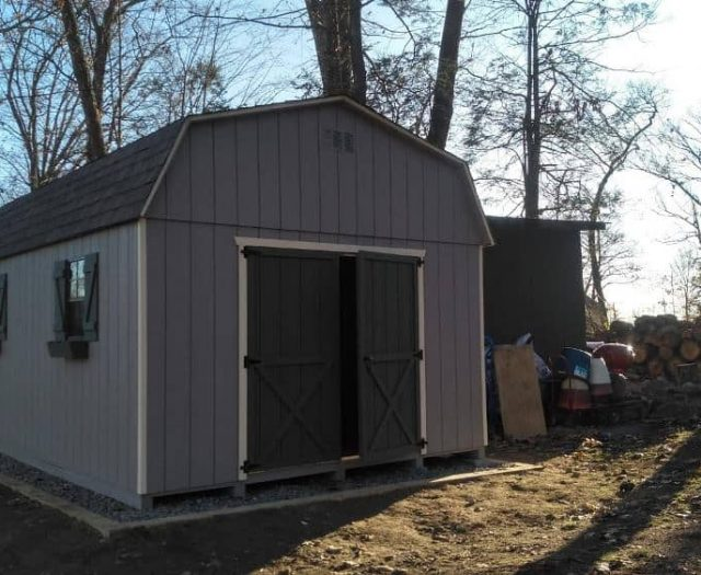 Dutch Barn Storage Shed with Blue T-111 Siding, Double Door, and Flower Boxes